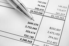 Financial statements. Ballpoint pen on financial statements Stock Photos
