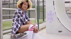 Cute woman in shorts at skating park Stock Footage