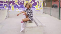 Female skateboarder in shorts at skating park Stock Footage