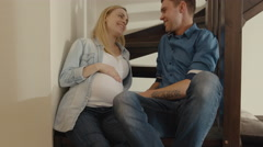 16 70 20 Maternity concept Couple Relaxing on Stairs at home - stock footage