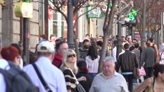 4K Crowded sidewalk pedestrian people commuter walk Madrid capital town city day Stock Footage