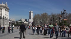 4K Crowded sidewalk pedestrian people relax public garden Madrid downtown day Stock Footage