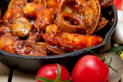 Fresh seafoos stew on an iron skillet Stock Photos