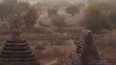 Bagan of Myanmar view against sun - camera moving up Stock Footage