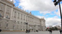 People walking near a Palacio Real in Madrid Stock Footage