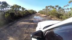 POV 4x4 driving on muddy path through big puddles - stock footage