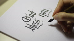 Writing Gothic calligraphy. female hand writes with ink pen - stock footage