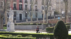 4K People relax walk green park Madrid downtown man enjoy sing song bench day Stock Footage