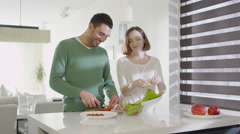 16 70 22 Couple Preparing Healthy Food at Kitchen - stock footage