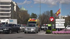 4K Traffic street Madrid downtown car wait red light police woman ambulance day  Stock Footage