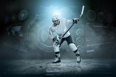 Ice hockey player on the ice around modern light Stock Photos