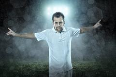 Stock Photo of Soccer player with ball in action outdoors