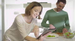 16 70 25 Woman using tablet on Kitchen - stock footage