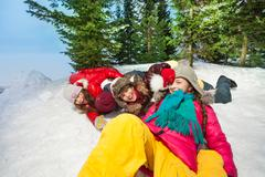 Happy kids sliding head over heels from the hill Stock Photos