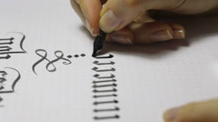 Writing Gothic calligraphy. female hand writes with ink pen Stock Footage