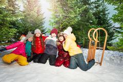 Friends in winter wear having happy time outside - stock photo