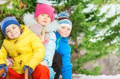Close portrait of little kids in winter clothes Kuvituskuvat