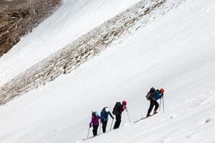 Climbers Ascending Glacier - stock photo