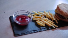 Guy puts fries in ketchup Stock Footage