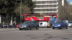 Stock Video Footage of 4K Traffic car street intersection touristic red bus Madrid town people commute