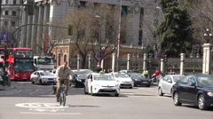 4K Heavy traffic street touristic red bus double decker car pass Madrid city day Stock Footage