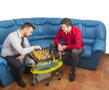 Friends Playing Chess - stock photo