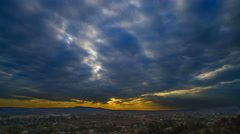 Flow of cloud over the city on the background of sunset. Time lapse. Wide angle Stock Footage