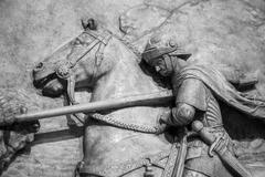 Bas-relief of knight with a spear striking dragon - stock photo
