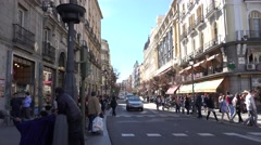 4K Traffic street car pass pedestrian people transit Madrid commercial road day  Stock Footage