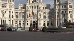 4K Tilt up Cybele Palace traffic street Madrid city center Cibeles building icon Stock Footage