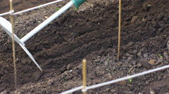 Plowing the ground with hand rake Stock Footage