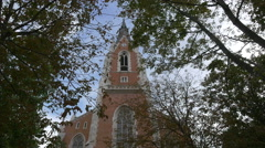 St. Elisabeth Church seen through the branches of surrounding trees, Vienna Stock Footage