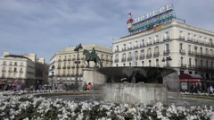 4K Pan right Puerta del Sol crowded square Madrid emblem Gate Sun attraction day Stock Footage