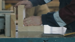 Close-up of running a board of lumber through a wood jointer power tool Stock Footage