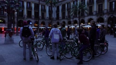 Group of bikers listen one lady, dusk Royal Plaza at Rambla dels Caputxins - stock footage