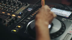 Dj playing and mixing music in a night club Stock Footage