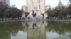 4K Tourist visit Don Quijote Sancho Panza statue Madrid icon Plaza Espana day Stock Footage
