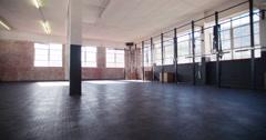 Establishing shot of a empty crossfit gym Stock Footage