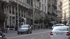 4K Traffic street commercial area Madrid downtown Via Gran avenue Great Way day Stock Footage