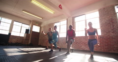Friends doing jumping lunges during a crossfit workout in the gym Stock Footage