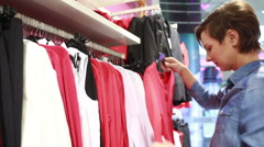 Pretty elegant woman shopping in clothes store Stock Footage