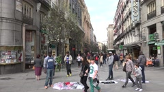 4K Crowded pedestrian road street seller Madrid commercial area shop sign day Stock Footage