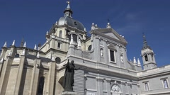 4K Saint John Paul statue famous Almudena cathedral architecture Madrid icon day Stock Footage