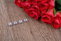 Cubes as a inscription love on a wooden background - stock photo
