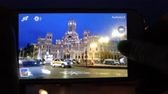 4K Tourist take phone mobile phone Cybele Palace traffic street Madrid emblem  Stock Footage