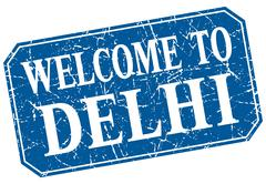 welcome to Delhi blue square grunge stamp - stock illustration
