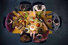 Top view of friends at table with food Stock Photos