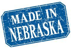 made in Nebraska blue square grunge stamp - stock illustration