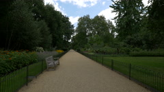 Alley with bench in Kensington Gardens in London Stock Footage