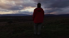 Boy at sunset - stock footage